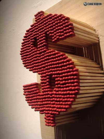 Знак доллара из спичек