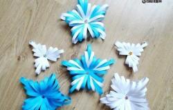 Объемная снежинка из бумажных полос в стиле квиллинг
